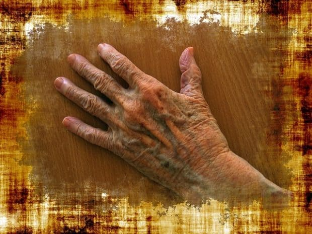 taking care of a husband with dementia artistic photo of an elderly hand on a colorful background Middle Class Dad