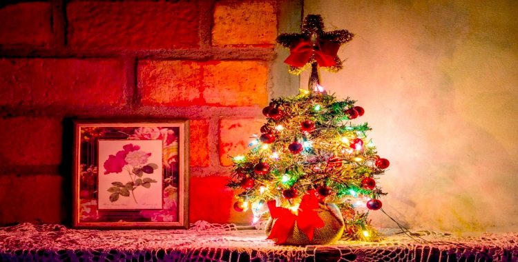 how to hang Christmas lights on brick walls Small Christmas tree on shelf in front of brick wall Middle Class Dad