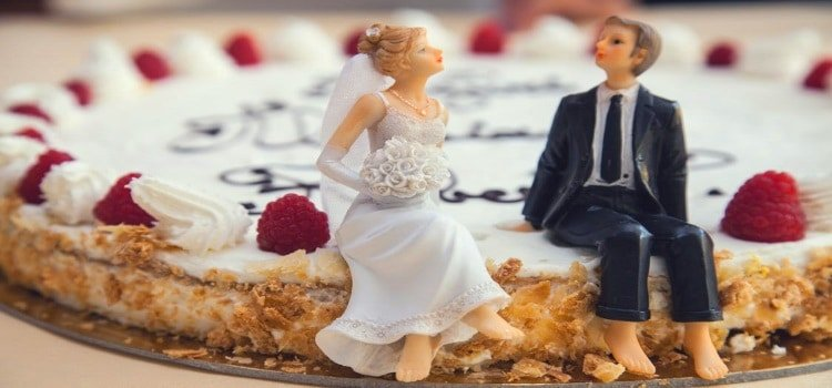 marriage statistics by age group Middle Class Dad wedding cake with 2 figurings as a bride and groom sitting on the edge