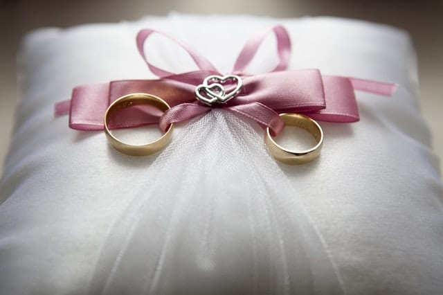 marriage statistics by age group Middle Class Dad 2 wedding rings tied to a pink bow on a white pillow
