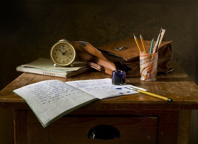 teacher burnout statistics Middle Class Dad empty table with a notebook, clock, books, pencils and a satchel