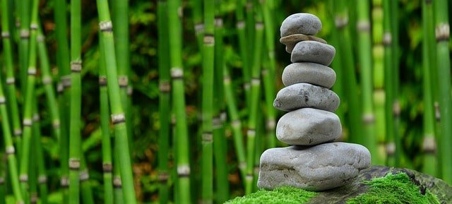 why go on a spiritual retreat Middle Class Dad a stack of well balanced rocks on the edge of a bamboo forest