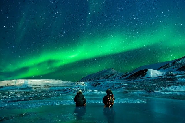 what is trekking all about? Middle Class Dad 2 people in Alaska staring at the Northern Lights
