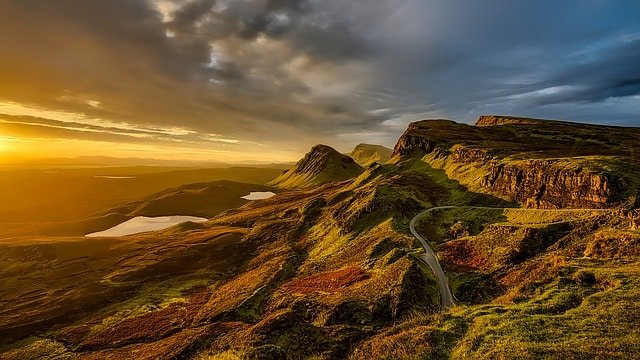 what is trekking all about? Middle Class Dad a windy road through the mountains of Scotland at sunset