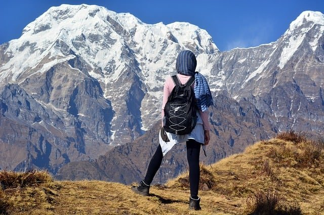 what is trekking all about? Middle Class Dad woman on in Nepal staring at the Himilayas