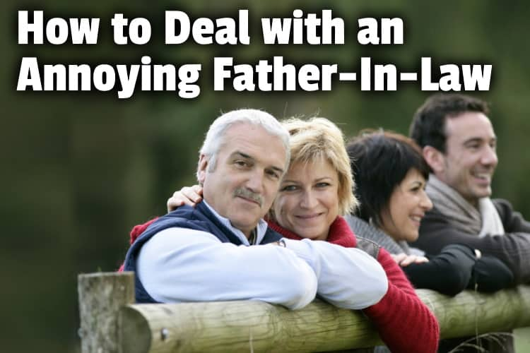 young couple with inlaws outside by a wood fence